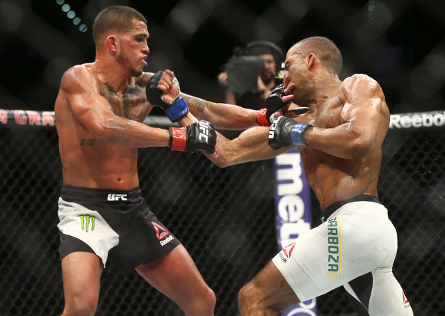 Edson Barboza, right, and Anthony Pettis trade punches during a lightweight bout in UFC 197 at the MGM Grand Garden Arena in Las Vegas on Saturday, April 23, 2016. Barboza won by unanimous decisio ...