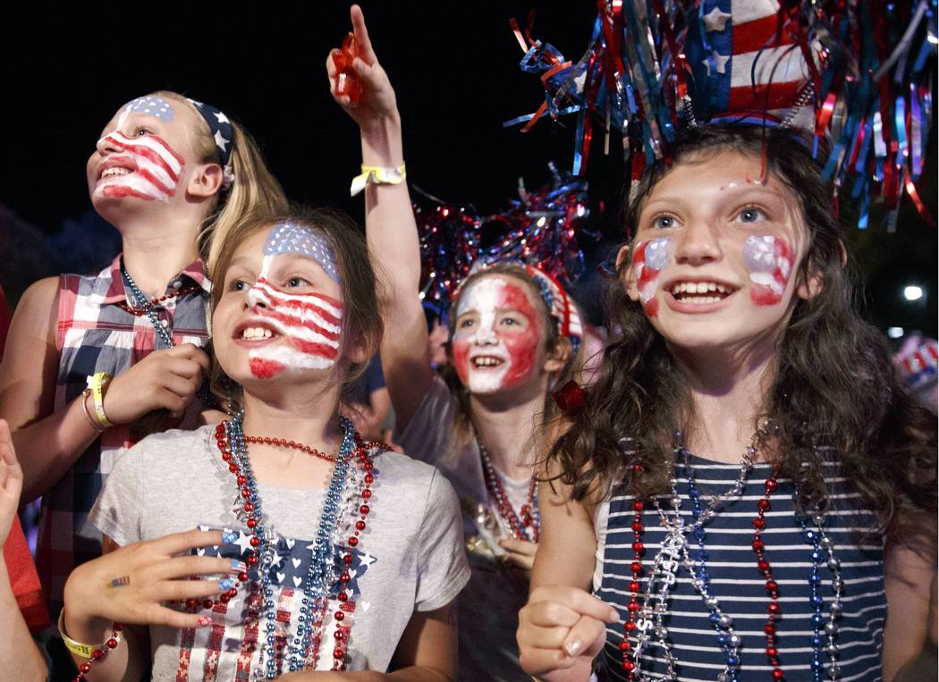 Children sing along during a rehearsal for the annual Boston Pops Fireworks Spectacular on the Esplanade, Monday, July 3, 2017, in Boston. (AP Photo/Michael Dwyer)
