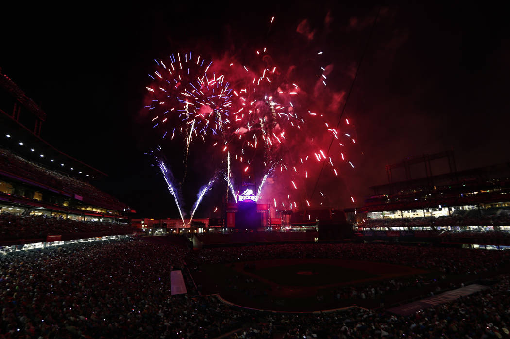 Fireworks explode over Coors Field to mark the Independence Day holiday after the Colorado Rockies hosted the Cincinnati Reds in a baseball game Monday, July 3, 2017, in Denver. The Rockies won 5- ...