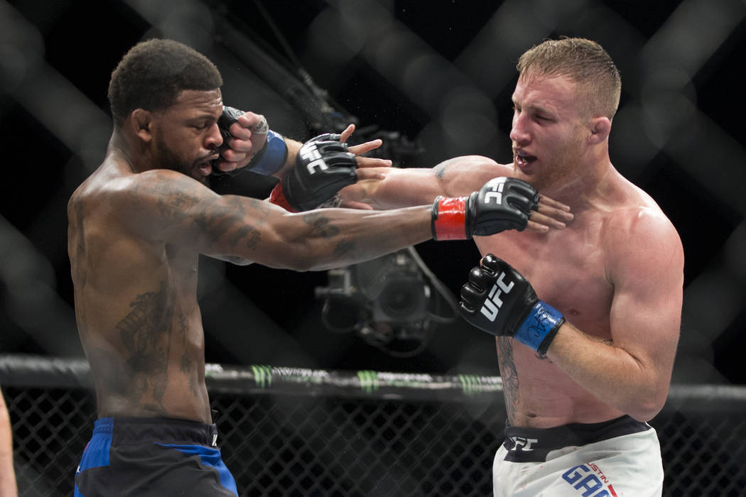 Michael Johnson, left, battles Justin Gaethje in The Ultimate Fighter 25 lightweight bout at T-Mobile Arena in Las Vegas, Friday, July 7, 2017. Gaethje won by technical knockout. Erik Verduzco Las ...