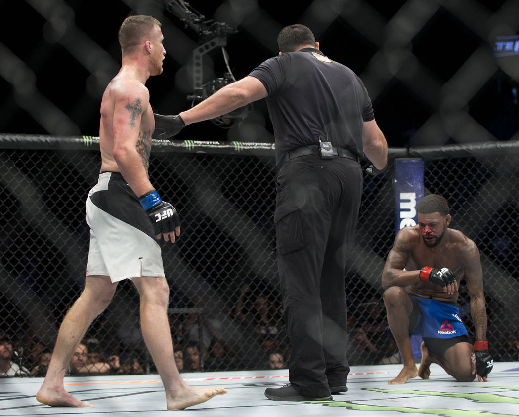 Justin Gaethje, left, battles Michael Johnson in The Ultimate Fighter 25 lightweight bout at T-Mobile Arena in Las Vegas, Friday, July 7, 2017. Gaethje won by technical knockout. Erik Verduzco Las ...