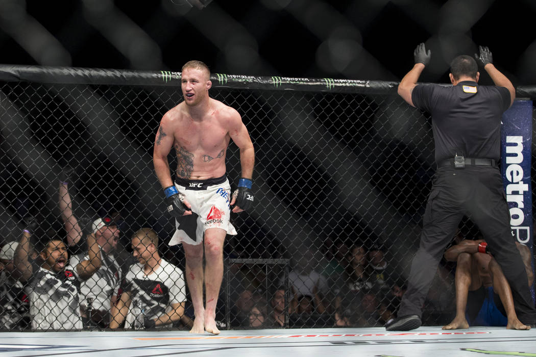 Justin Gaethje, left, reacts to his technical knockout win against Michael Johnson in The Ultimate Fighter 25 lightweight bout at T-Mobile Arena in Las Vegas, Friday, July 7, 2017. Erik Verduzco L ...