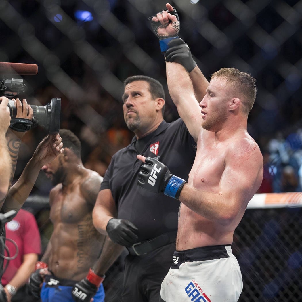 Justin Gaethje is announced the winner in his fight against Michael Johnson in The Ultimate Fighter 25 lightweight bout at T-Mobile Arena in Las Vegas, Friday, July 7, 2017. Gaethje won by technic ...