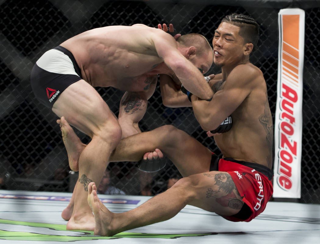 Gray Maynard, left, takes down Teruto Ishihara during the The Ultimate Fighter 25 featherweight bout in Las Vegas, Friday, July 7, 2017. Maynard won by unanimous decision. Erik Verduzco Las Vegas  ...