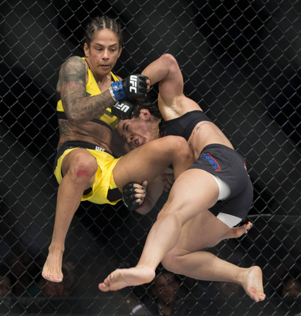 Juliana Lima, left, is taken down by Tecia Torres during the The Ultimate Fighter 25 women's strawweight bout at T-Mobile Arena in Las Vegas, Friday, July 7, 2017. Torres won by way of submission. ...