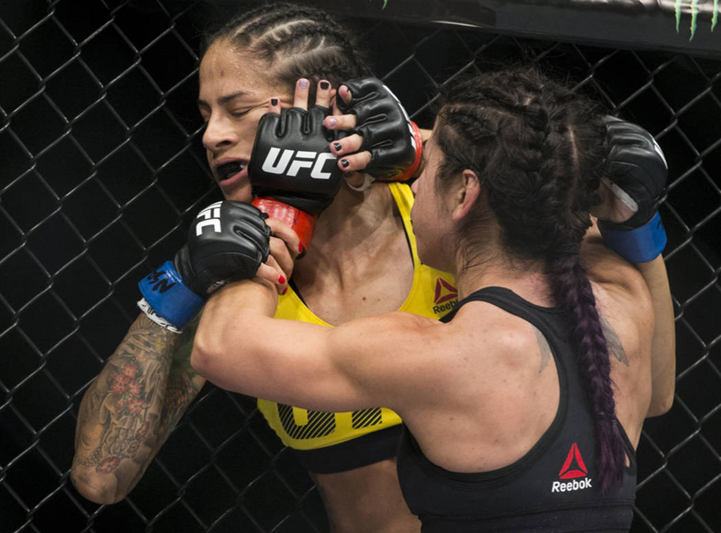 Juliana Lima, left, battles Tecia Torres during the The Ultimate Fighter 25 women's strawweight bout at T-Mobile Arena in Las Vegas, Friday, July 7, 2017. Torres won by way of submission. Erik Ver ...