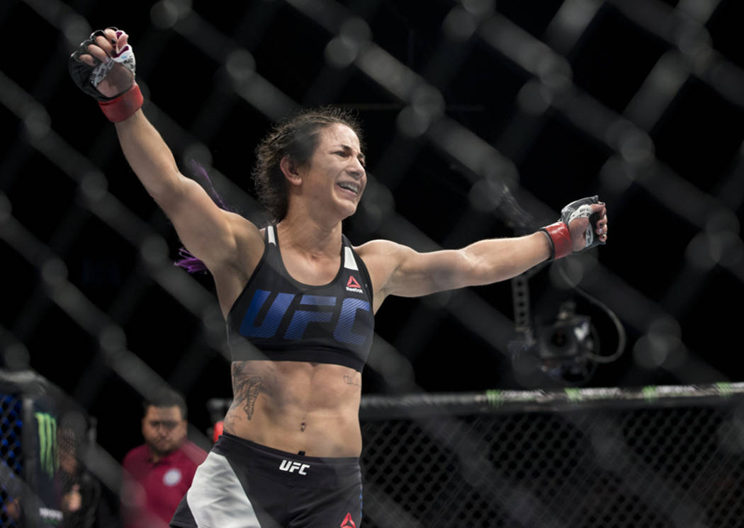 Tecia Torres celebrates her submission victory against Juliana Lima during the The Ultimate Fighter 25 women's strawweight bout at T-Mobile Arena in Las Vegas, Friday, July 7, 2017. Erik Verduzco  ...