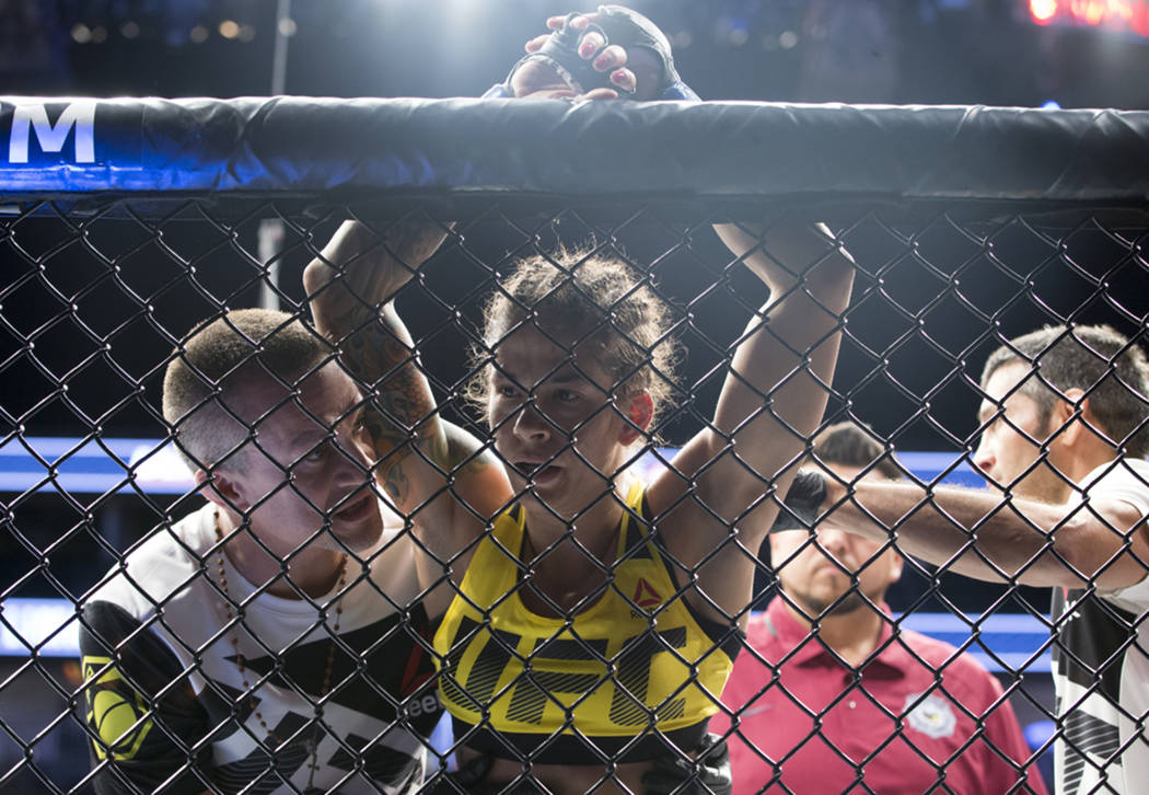 Juliana Lima reacts after her submission loss against Tecia Torres during the The Ultimate Fighter 25 women's strawweight bout at T-Mobile Arena in Las Vegas, Friday, July 7, 2017. Erik Verduzco L ...