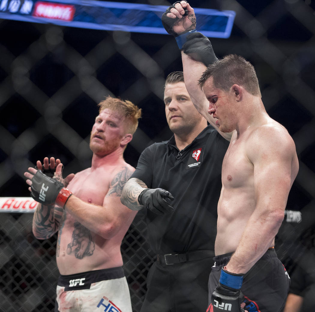 C.B. Dollaway, right, celebrates his win against Ed Herman during the The Ultimate Fighter 25 light heavyweight bout at T-Mobile Arena in Las Vegas, Friday, July 7, 2017. Erik Verduzco Las Vegas R ...
