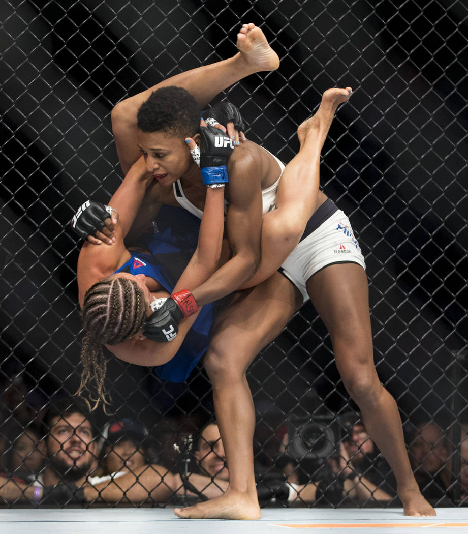 Angela Hill, top, battles Ashley Yoder in the The Ultimate Fighter 25 strawweight bout at T-Mobile Arena in Las Vegas, Friday, July 7, 2017. Hill won by unanimous decision. Erik Verduzco Las Vegas ...