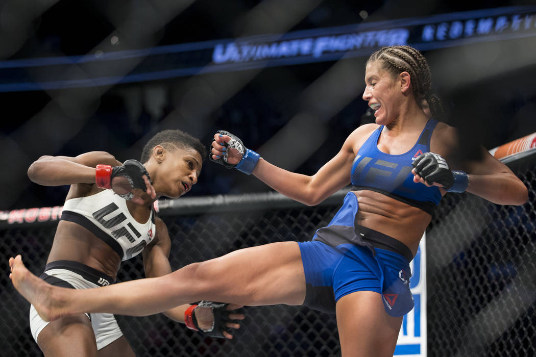 Angela Hill, left, battles Ashley Yoder in the The Ultimate Fighter 25 women's strawweight bout at T-Mobile Arena in Las Vegas, Friday, July 7, 2017. Hill won by unanimous decision. Erik Verduzco  ...