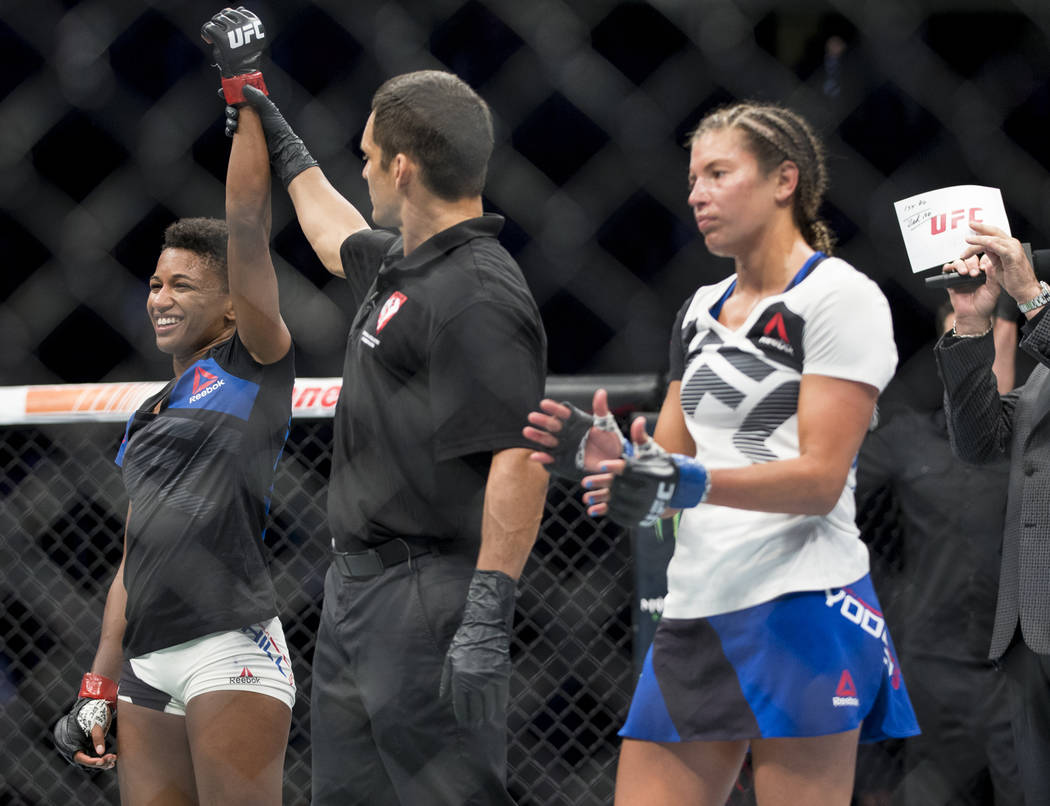 Angela Hill, left, reacts after her unanimous decision win against Ashley Yoder in the The Ultimate Fighter 25 strawweight bout at T-Mobile Arena in Las Vegas, Friday, July 7, 2017. Erik Verduzco  ...