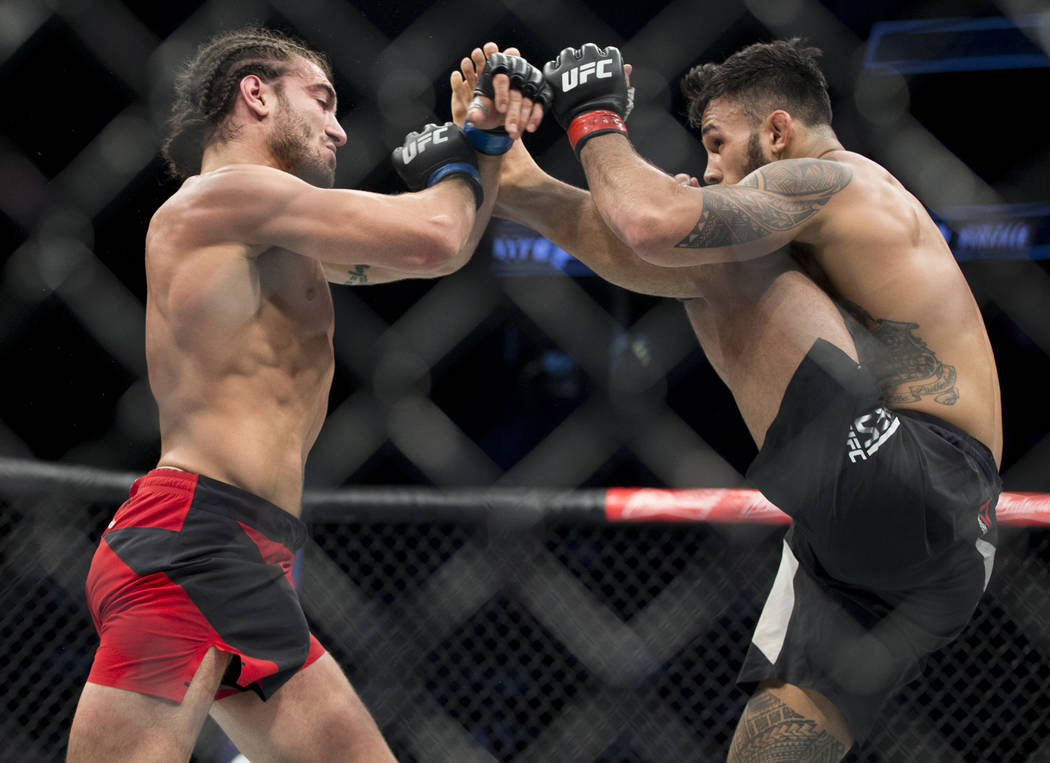 Elias Theodorou, left, battles Brad Tavares in The Ultimate Fighter 25 middleweight bout at T-Mobile Arena in Las Vegas, Friday, July 7, 2017. Tavares won by unanimous decision. Erik Verduzco Las  ...