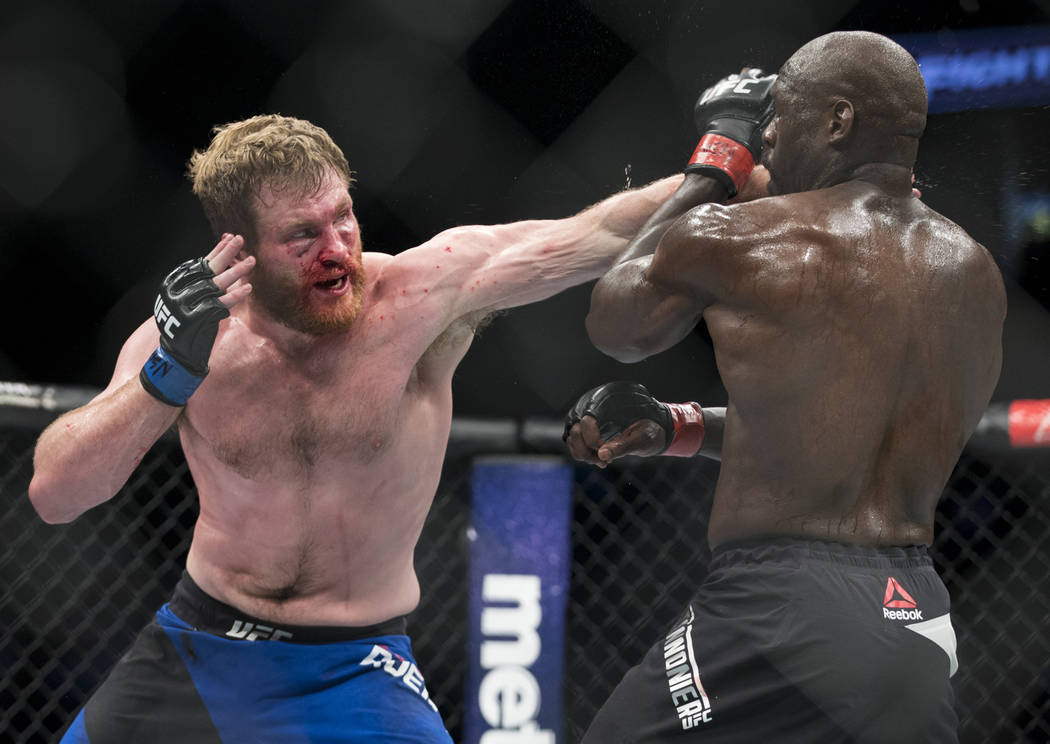 Nick Roehrick, left, battles Jared Cannonier in The Ultimate Fighter 25 light heavyweight bout at T-Mobile Arena in Las Vegas, Friday, July 7, 2017. Cannonier won by technical knockout. Erik Verdu ...