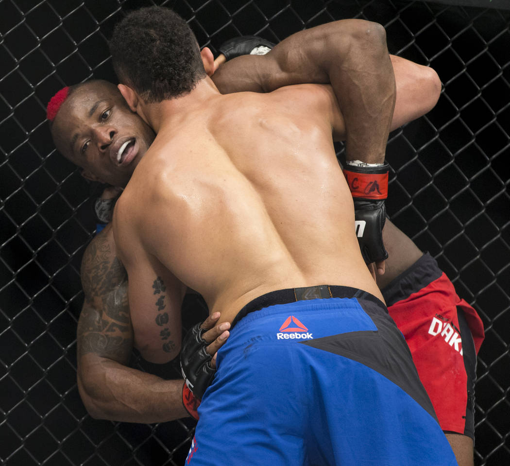 Drakkar Klose, front, battles Marc Diakiese in The Ultimate Fighter 25 lightweight bout at T-Mobile Arena in Las Vegas, Friday, July 7, 2017. Klose won by split decision. Erik Verduzco Las Vegas R ...