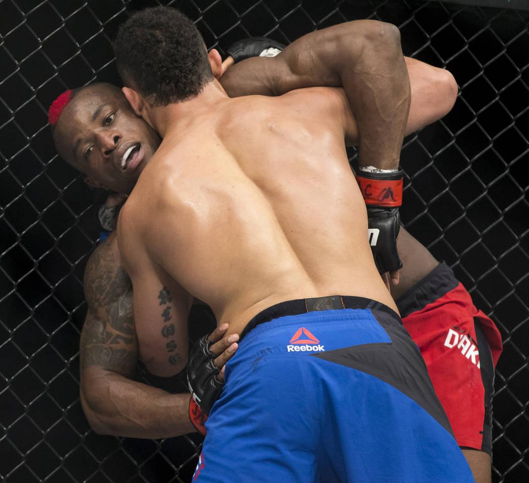 Drakkar Klose, front, battles Marc Diakiese in The Ultimate Fighter 25 lightweight bout at T-Mobile Arena in Las Vegas, Friday, July 7, 2017. Klose won by split decision. Erik Verduzco Las Vegas R ...