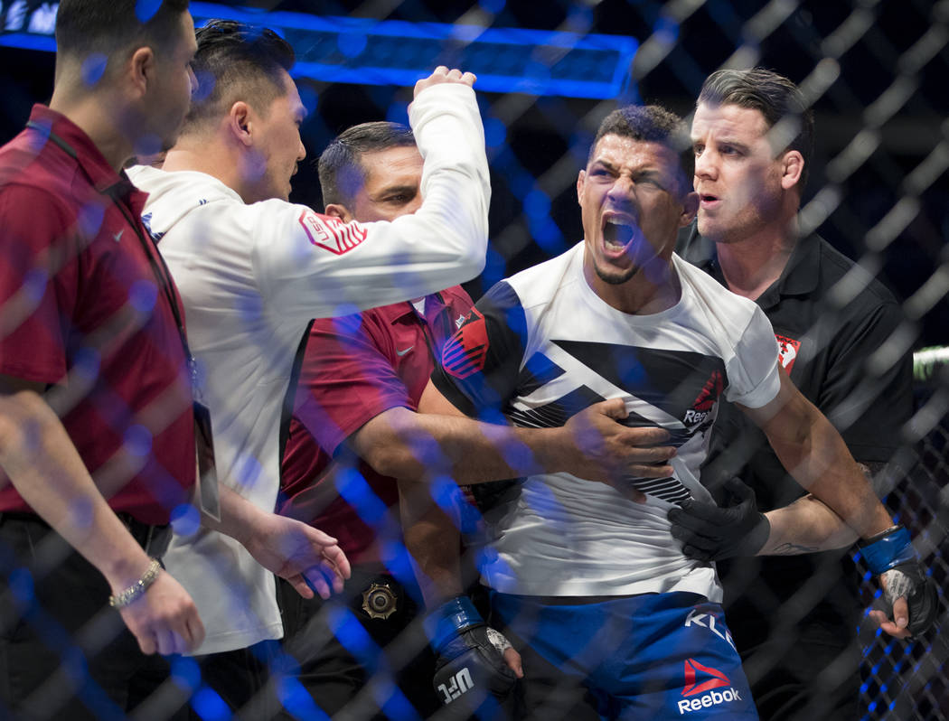 Drakkar Klose reacts after he was announced the winner by split decision against Marc Diakiese in The Ultimate Fighter 25 lightweight bout at T-Mobile Arena in Las Vegas, Friday, July 7, 2017. Eri ...