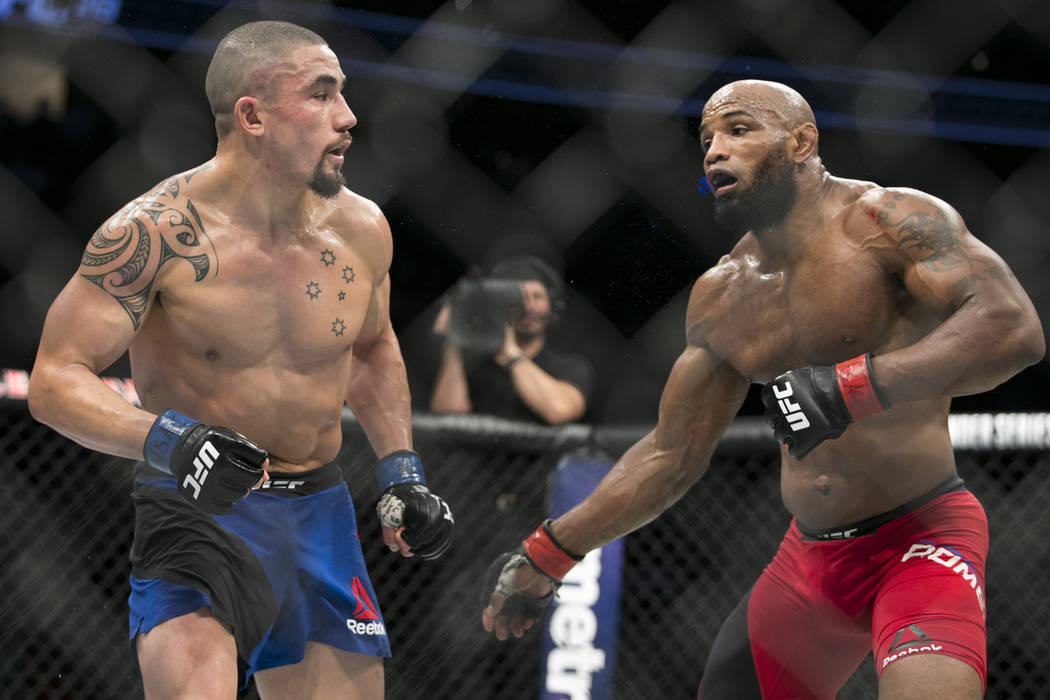 Robert Whittaker, left, battles Yoel Romero in the UFC 213 interim middleweight title bout at T-Mobile Arena in Las Vegas, Saturday, July 8, 2017. Whittaker won by unanimous decision. Erik Verduzc ...