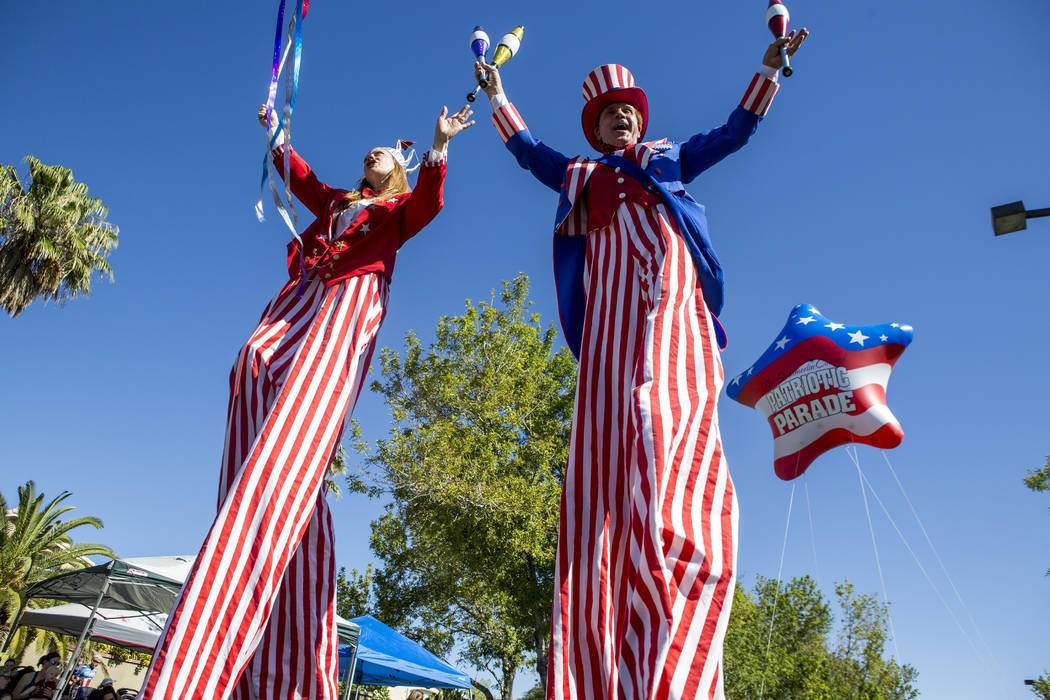 Patriotic stilt walkers wave to crowds during the Summerlin Council Patriotic Parade in Summerlin on Tuesday, July 4, 2017. (Patrick Connolly/Las Vegas Review-Journal) @PConnPie