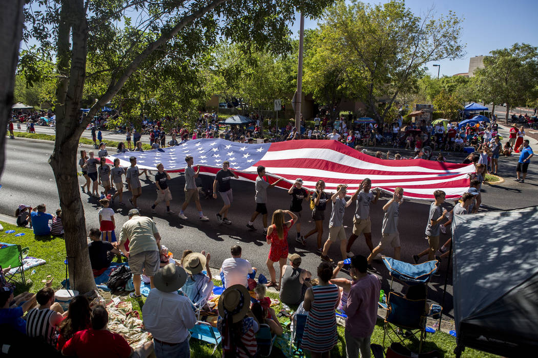 Members of Palo Verde cross country cary a giant American Flag during the Summerlin Council Patriotic Parade in Summerlin on Tuesday, July 4, 2017.  (Patrick Connolly/Las Vegas Review-Journal) @PC ...