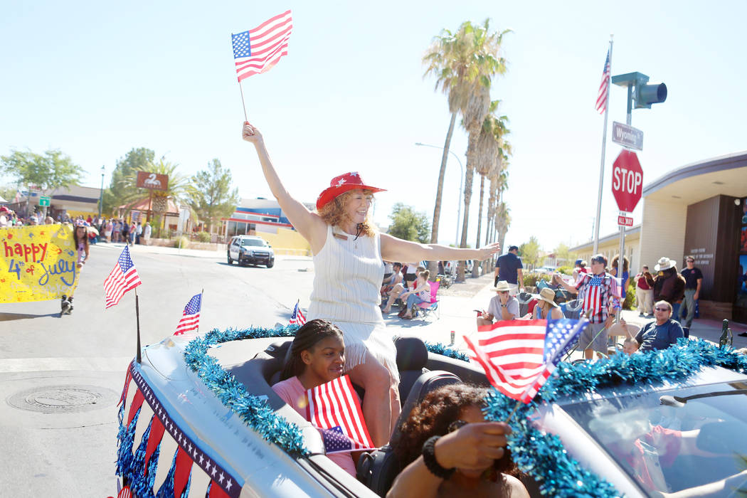 Clark County Clerk Lynn Marie Goya waves a flag during the 69th Annual Boulder City Damboree parade in Boulder City, Tuesday, July, 4, 2017. (Elizabeth Brumley/Las Vegas Review-Journal)