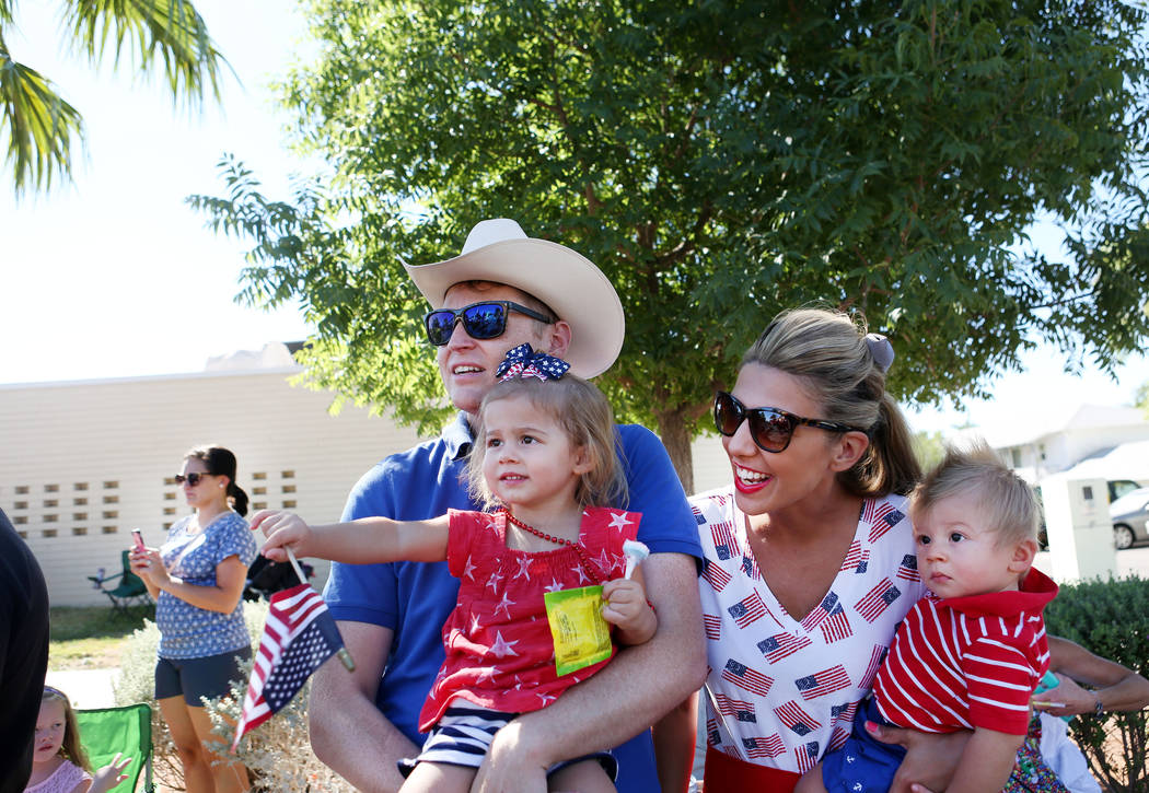The Flake family watches the 69th Annual Boulder City Damboree parade in Boulder City, Tuesday, July, 4, 2017. (Elizabeth Brumley/Las Vegas Review-Journal)