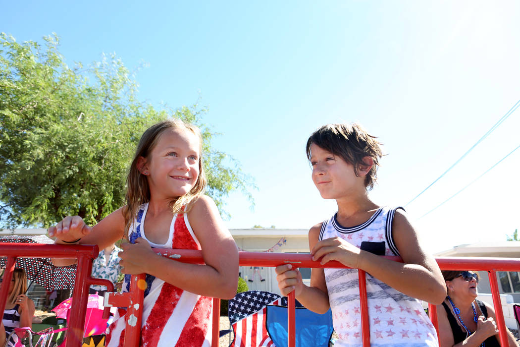 Twins Lorelai, left, and Oliver Hudgins, 8, watch the 69th Annual Boulder City Damboree parade in Boulder City, Tuesday, July, 4, 2017. (Elizabeth Brumley/Las Vegas Review-Journal)