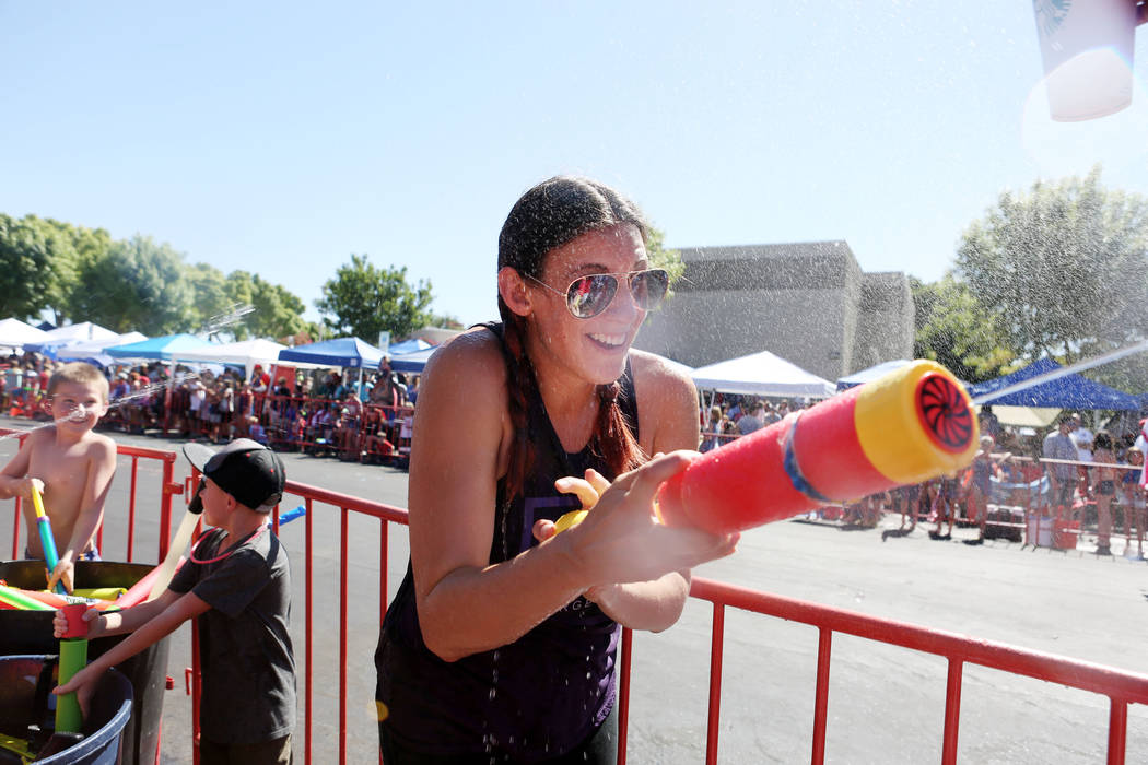 Amy Kowalski sprays her water toy before the water war part of the 69th Annual Boulder City Damboree Celebration in Boulder City, Tuesday, July, 4, 2017. (Elizabeth Brumley/Las Vegas Review-Journal)