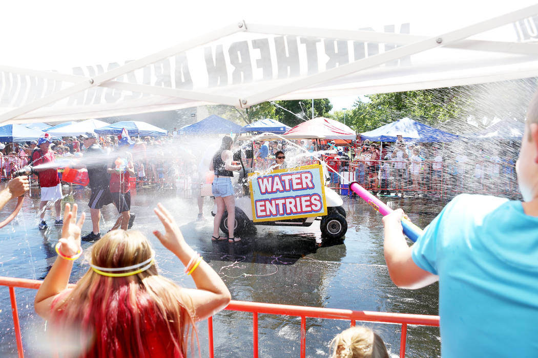 Water is sprayed during the water war part of the 69th Annual Boulder City Damboree Celebration in Boulder City, Tuesday, July, 4, 2017. (Elizabeth Brumley/Las Vegas Review-Journal)
