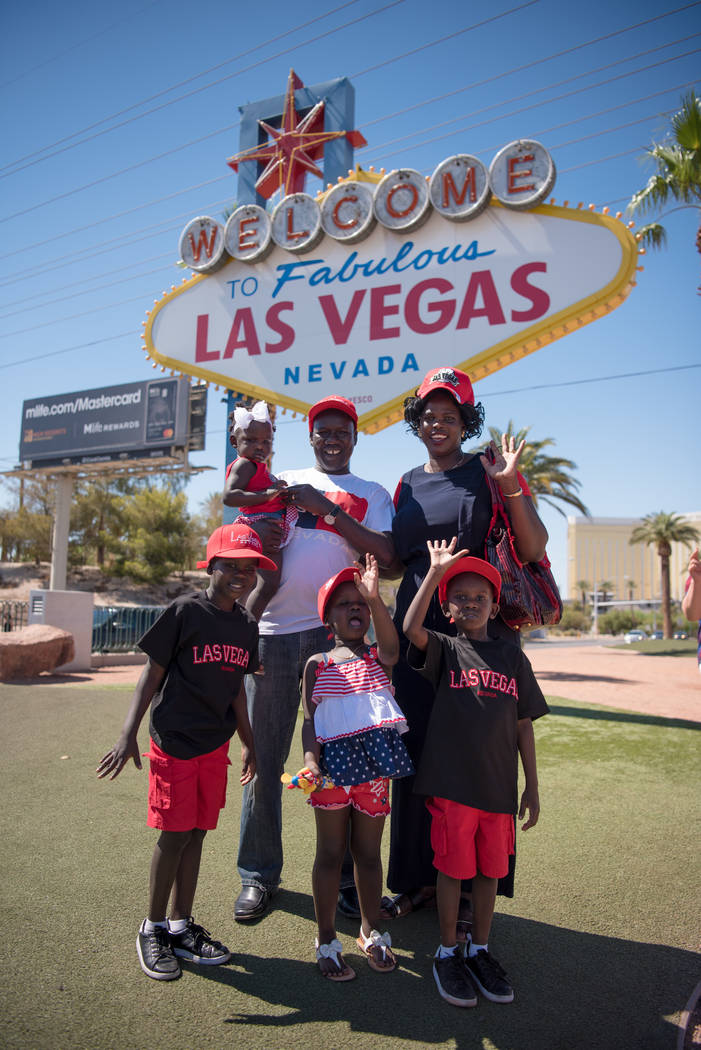 The Ajak family in front of the landmark Las Vegas sign on Tuesday, July 4, 2017, in Las Vegas. Morgan Lieberman Las Vegas Review-Journal