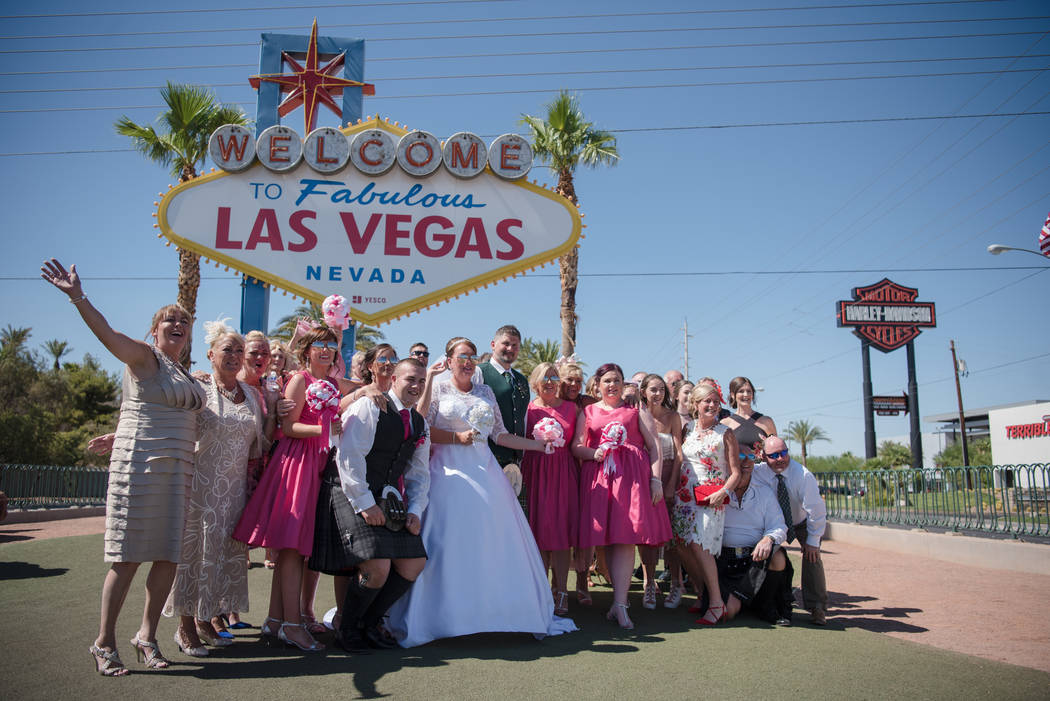 The Coyle/Smyth wedding party, from Scotland, posing in front of the landmark Las Vegas sign on Tuesday, July 4, 2017, in Las Vegas. Morgan Lieberman Las Vegas Review-Journal
