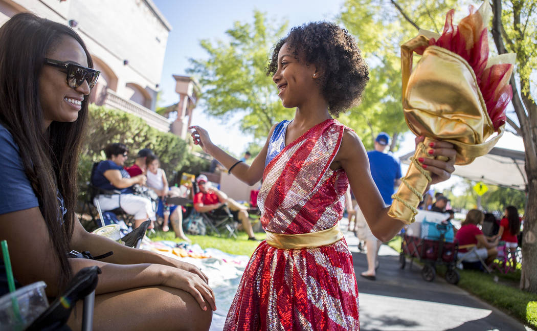 Brooklynn Winslow, 8, shows off her sparkly American flag dress and torch while her mother Natalie Winslow smiles during the Summerlin Council Patriotic Parade in Summerlin on Tuesday, July 4, 201 ...