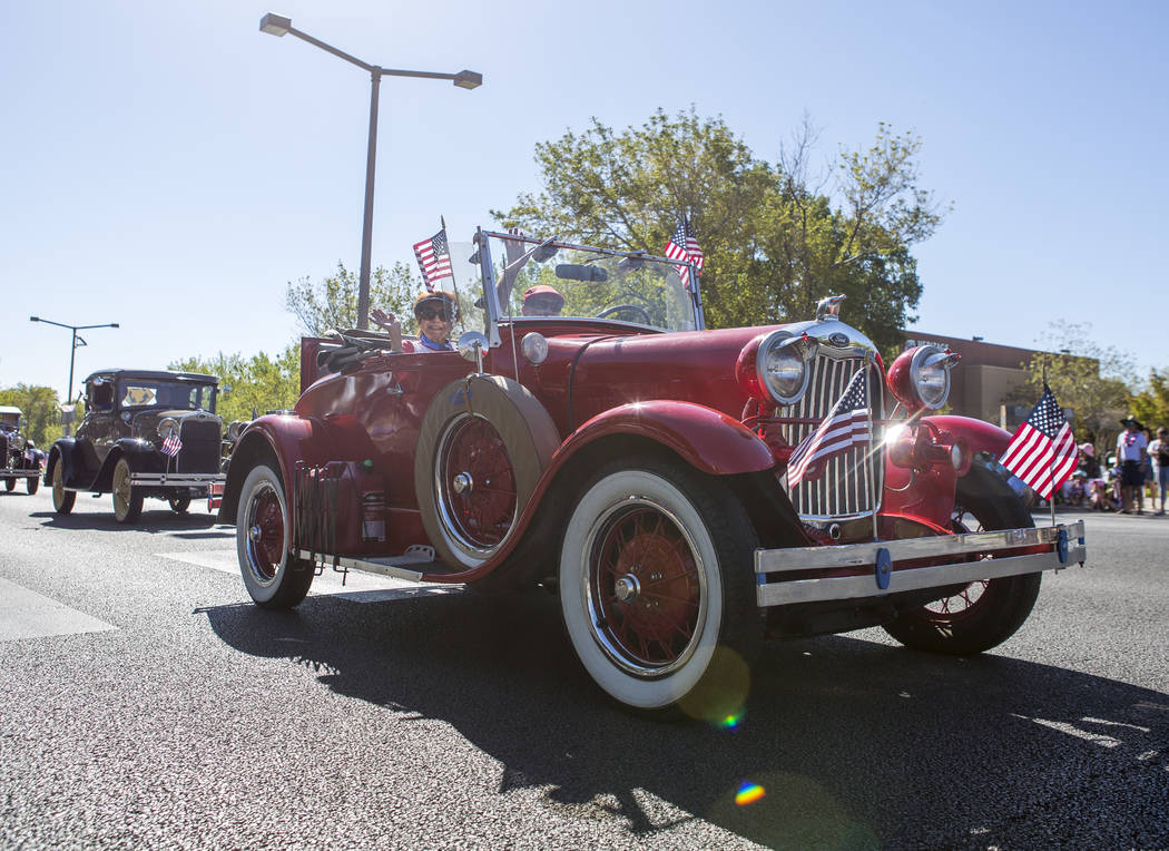 Antique cars cruise down Village Center Circle during the Summerlin Council Patriotic Parade in Summerlin on Tuesday, July 4, 2017.  (Patrick Connolly/Las Vegas Review-Journal) @PConnPie