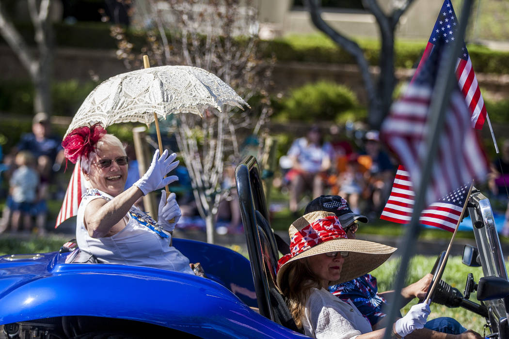 A woman waves to crowds during the Summerlin Council Patriotic Parade in Summerlin on Tuesday, July 4, 2017. (Patrick Connolly/Las Vegas Review-Journal) @PConnPie