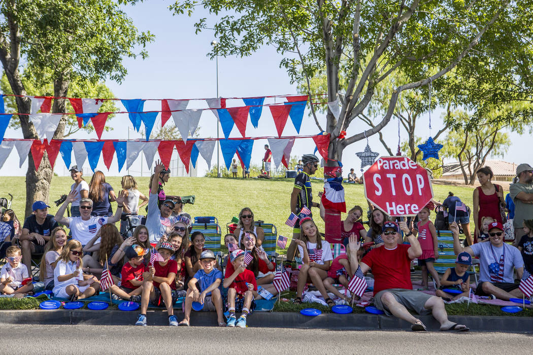 "Patriotic paradegoers cheer for upcoming floats and hold a ""Parade STOP here"" sign during the Summerlin Council Patriotic Parade in Summerlin on Tuesday, July 4, 2017. (Patrick Connolly/Las Vegas  ..."