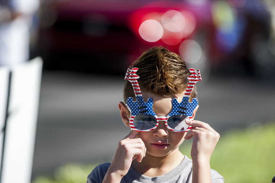 A young paradegoer adjusts his glasses during the Summerlin Council Patriotic Parade in Summerlin on Tuesday, July 4, 2017. (Patrick Connolly/Las Vegas Review-Journal) @PConnPie