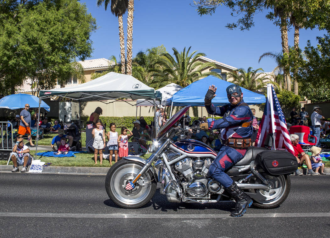 Captain America waves to crowds during the Summerlin Council Patriotic Parade in Summerlin on Tuesday, July 4, 2017. (Patrick Connolly/Las Vegas Review-Journal) @PConnPie