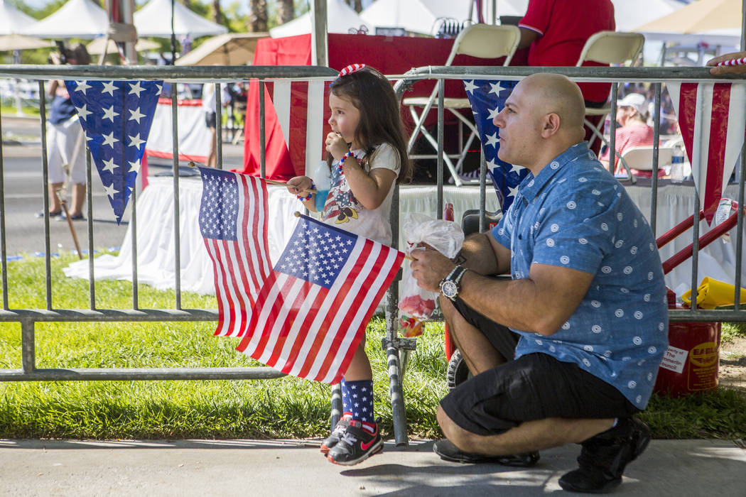 Lara Francon, 4, watches the parade with her father Santi Francon during the Summerlin Council Patriotic Parade in Summerlin on Tuesday, July 4, 2017. (Patrick Connolly/Las Vegas Review-Journal) @ ...