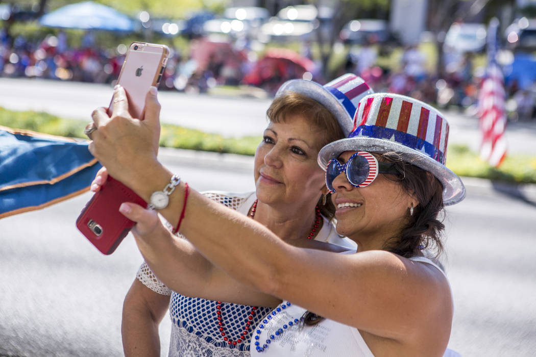 Yesenia Woolard, right, takes a selfie with her mother Deyanira Reyna during the Summerlin Council Patriotic Parade in Summerlin on Tuesday, July 4, 2017.  (Patrick Connolly/Las Vegas Review-Journ ...