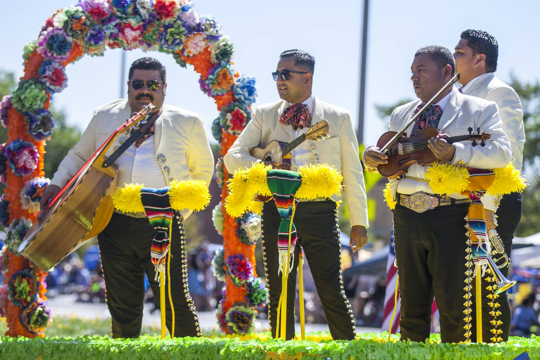 A Mariachi Band promoting Rancho's Mexican Restaurant looks out at crowds during the Summerlin Council Patriotic Parade in Summerlin on Tuesday, July 4, 2017.  (Patrick Connolly/Las Vegas Review-J ...