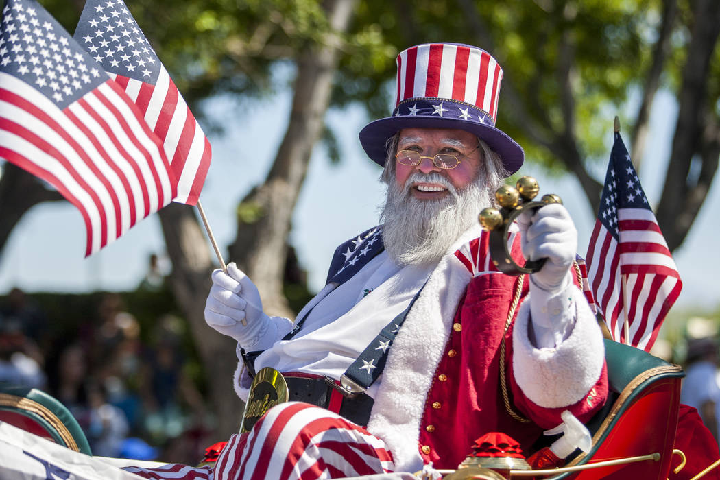 A patriotic Santa Claus smiles out to the crowds during the Summerlin Council Patriotic Parade in Summerlin on Tuesday, July 4, 2017.  (Patrick Connolly/Las Vegas Review-Journal) @PConnPie