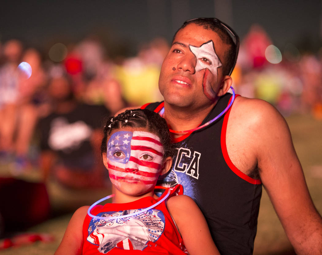 Las Vegas resident Jorge Zorio and his 9-year-old daughter  Alyna watch the fireworks at Heritage Park on Tuesday, July 4, 2017, in Henderson. Richard Brian Las Vegas Review-Journal