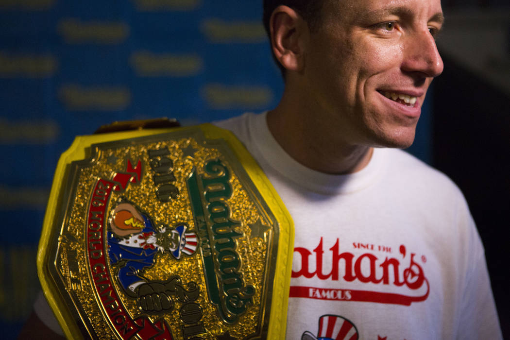 The current world hot dog eating champion, Joey Chestnut speaks to the media after the Nathan's Famous Hotdog eating contest weight in on Monday, July 3, 2017, in Brooklyn, New York. Chestnut weig ...
