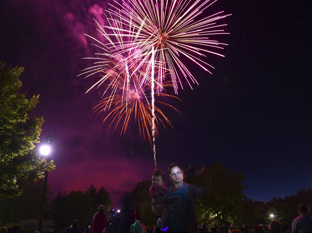 Tabatha Boyce takes a selfie during the fireworks display at Emerson Park in Auburn, N.Y., Monday July 3, 2017. (Kevin Rivoli/The Citizen via AP)