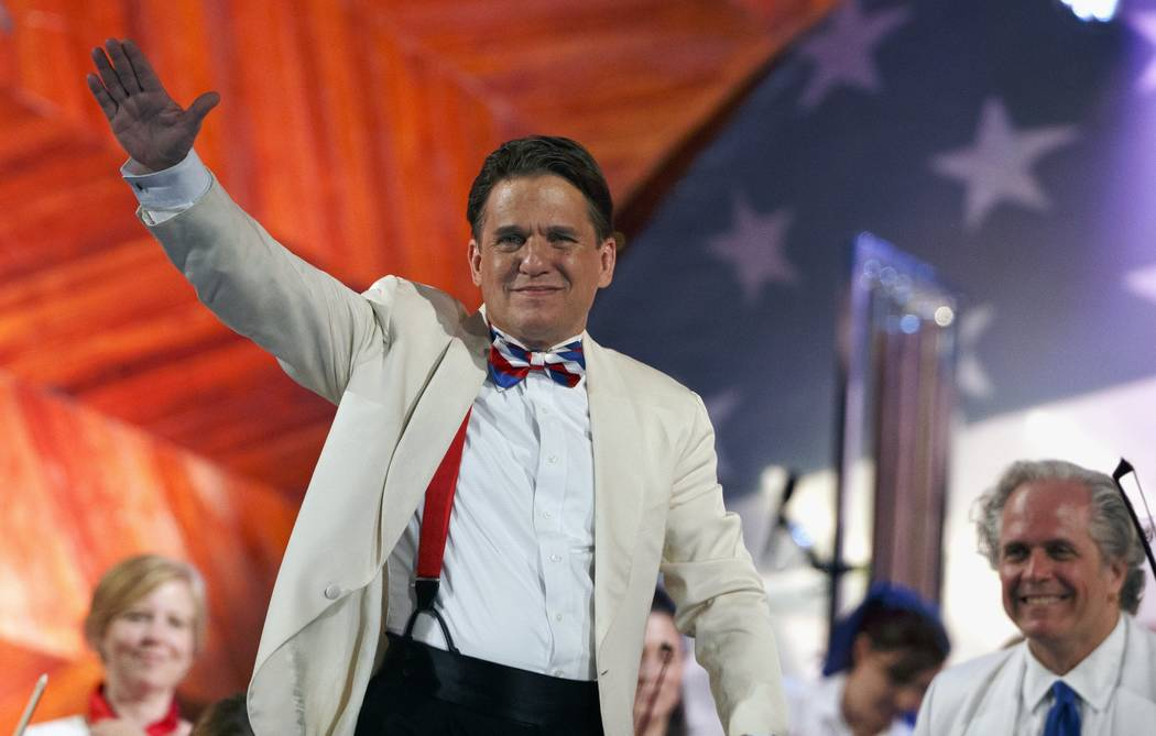 Conductor Keith Lockhart waves during a rehearsal for the annual Boston Pops Fireworks Spectacular on the Esplanade, Monday, July 3, 2017, in Boston. (Michael Dwyer/AP)