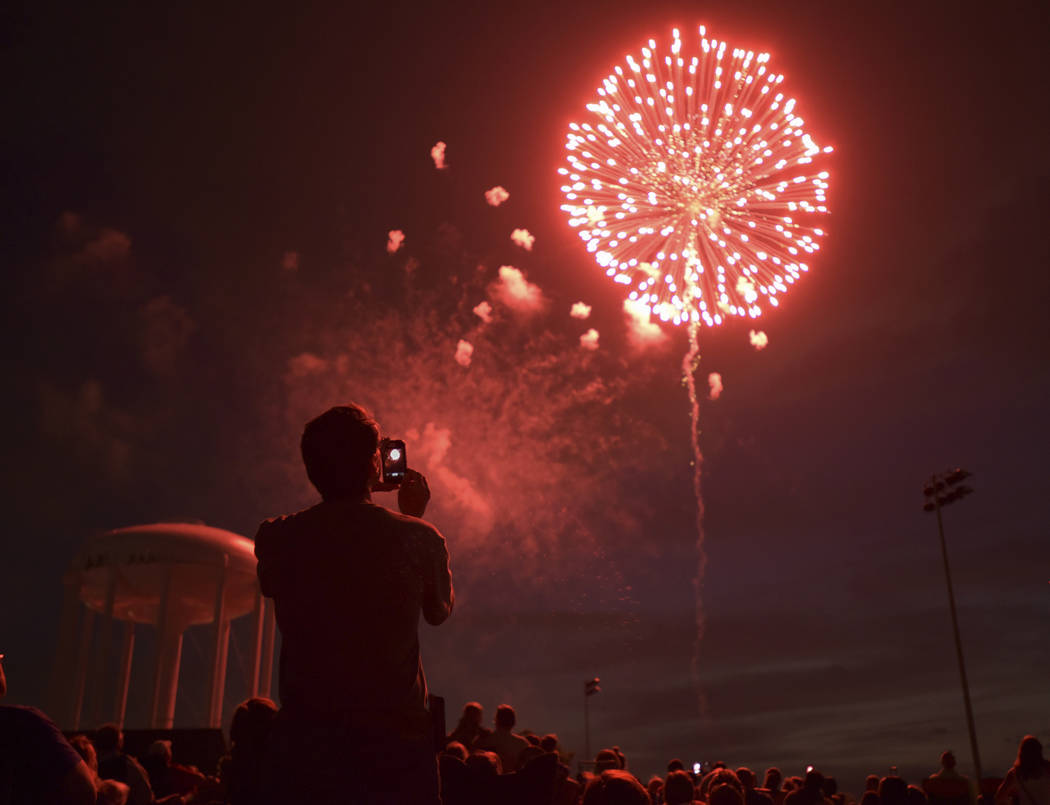 People watch fireworks at Graf Park over Wheaton, Ill., Monday July 3, 2017. (Mark Black/Daily Herald via AP)