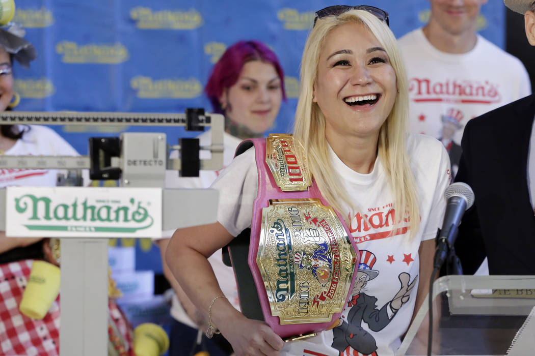 Current women's champion Miki Sudo, of Las Vegas, holds her championship belt during the weigh-in for the 2017 Nathan's Hot Dog Eating Contest, in Brooklyn Borough Hall, in New York, Monday, July  ...