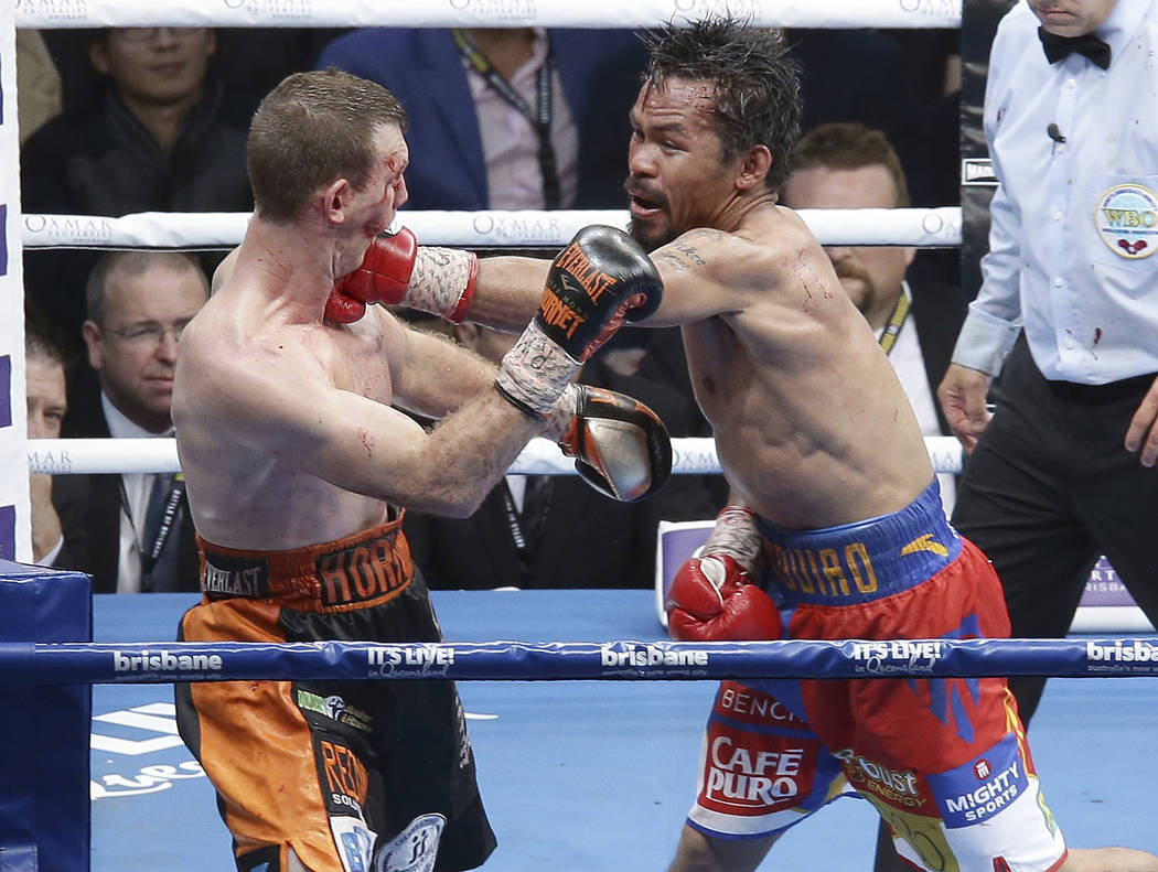 Jeff Horn, left, of Australia and Manny Pacquiao of the Philippines fight during their WBO World welterweight title bout in Brisbane, Australia, Sunday, July 2, 2017. Pacquiao lost his WBO welterw ...