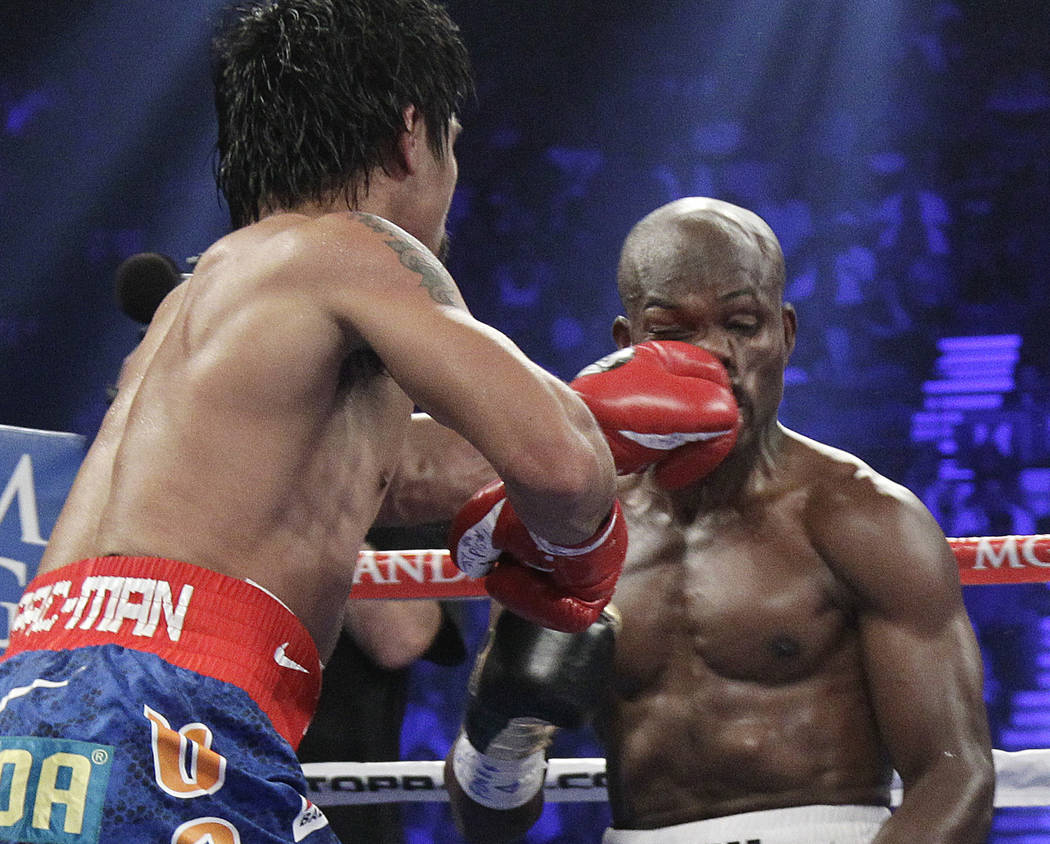 Manny Pacquiao, from the Philippines, left, lands a punch to the face of Timothy Bradley, from Palm Springs, Calif., in the fourth round of their WBO welterweight title fight Saturday, June 9, 201 ...