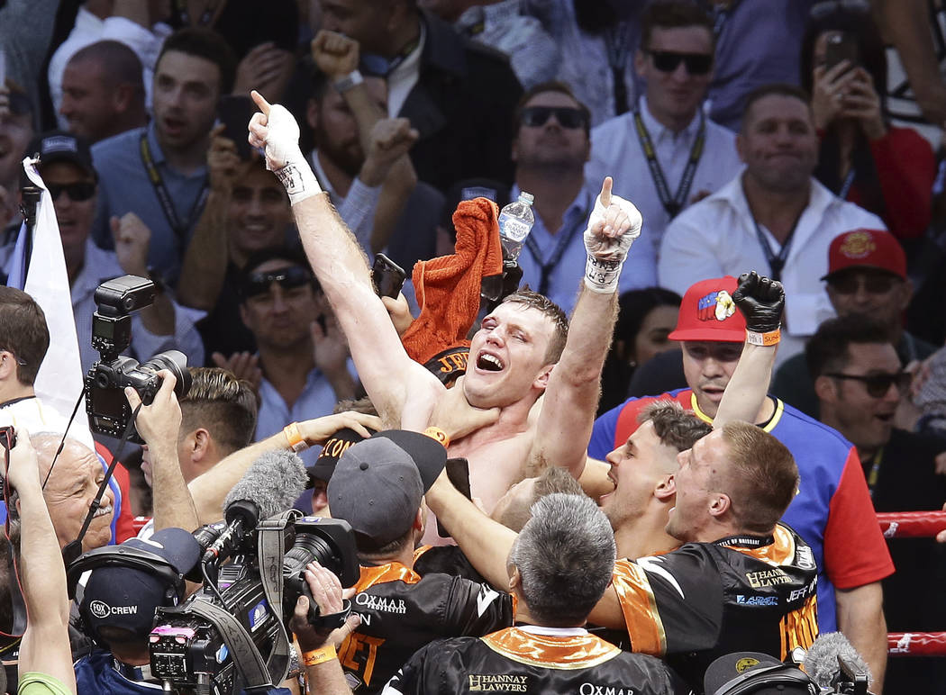 Jeff Horn of Australia celebrates after beating Manny Pacquiao of the Philippines during their WBO World Welterweight title fight in Brisbane, Australia, Sunday, July 2, 2017. (AP Photo/Tertius Pi ...